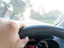 Hand of male steering wheel. Man driving car Stock Photo