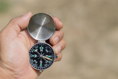 Hand man catch the compass.  Royalty Free Stock Image