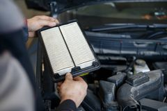 Hand a man change and check air filter of car in the engine room royalty free stock photo