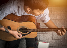 Hand of man in classical guitar.  Stock Image