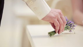 Hand man closeup with a bouquet of lavender. Hands of men and women closeup with a bouquet of flowers. stock video footage