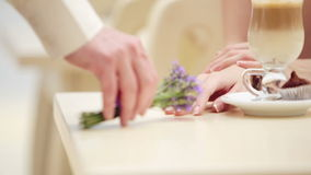 Hand man closeup with a bouquet of lavender. Hands of men and women closeup with a bouquet of flowers. stock video