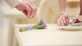 Hand man closeup with a bouquet of lavender. Hands of men and women closeup with a bouquet of flowers. stock footage