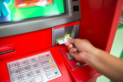 Hand of man with credit card, using a ATM Stock Photography