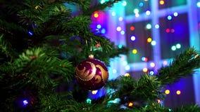 Hand man decorating on Christmas tree with Christmas glow lights. stock video