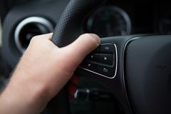 Hand of man driving a car Stock Photography
