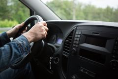 Hand of man driving a car Stock Images