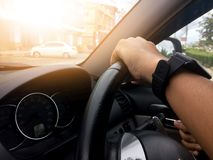 Hand of man driving inside car. royalty free stock photo