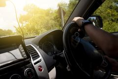 Hand of man driving inside car. stock photos