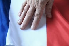 Hand of man on French flag Royalty Free Stock Photography