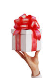 Hand of the man with a gift. The businessman offering to you a gift Royalty Free Stock Photos