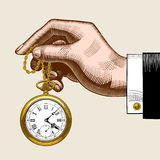 Hand of man with a gold retro pocket watch. Vintage color stylized drawing. There is in addition a vector format EPS 8 Stock Photography