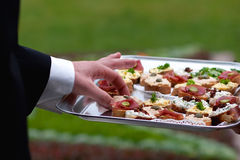 Hand of man grabbing food Royalty Free Stock Photos