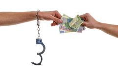 Hand of man in handcuffs giving bribe Stock Photography