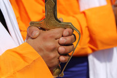 Hand of man and hilt of the sword during the event. Hand of a sikh man and hilt of the sword during the parade Royalty Free Stock Photo