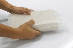 Hand man hold bubble wrap, for Packing and protection product cracked Stock Photography