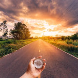 Hand man holding compass on road Royalty Free Stock Photo