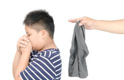 Hand man holding dirty stinky socks isolated. On white background, unpleasant smell concept royalty free stock images