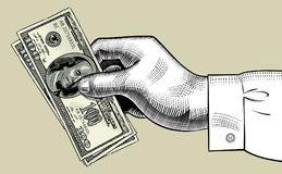 Hand of man holding 100 dollars bank notes. Vintage engraving stylized drawing. There is in addition a vector format EPS 8 Royalty Free Stock Photos