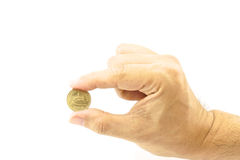 Hand of man holding gold coin. On the white background Royalty Free Stock Photos