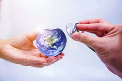 Hand man holding heart earth and listening to heart royalty free stock photos