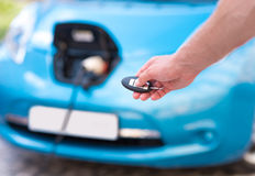Hand of man holding key for car Royalty Free Stock Images