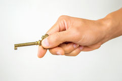The hand of a man is holding a key Royalty Free Stock Photos