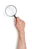Hand of man holding the magnifying glass isolated on white background Stock Photos