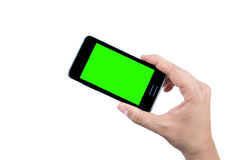 Hand of man holding mobile smart phone with chroma key green screen on white background Royalty Free Stock Images