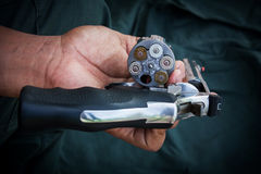 Hand man holding show gun  storage cylinder .357 magmun Royalty Free Stock Photography