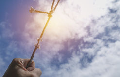 Hand of man holding on to the rope it`s almost absent under the. Sky Stock Images