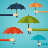 Hand of man holding an umbrella. Royalty Free Stock Photos
