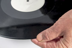 The hand of a man holding a vinyl record Royalty Free Stock Photos