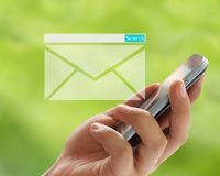 Hand of man holds a smartphone in search box and envelope symbol Royalty Free Stock Image