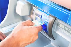 Hand of man insert card to atm machine. Electronic and financial concept Royalty Free Stock Image