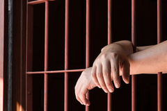 Hand of man in jail Royalty Free Stock Photo