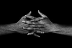 Hand of man join together on black. In white tone, adherence concept Royalty Free Stock Photos