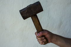 The hand of a man with a large hammer royalty free stock photos