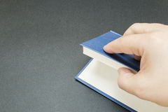 The hand of a man opening a book Royalty Free Stock Photography