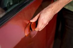 Hand of a man opening car door Royalty Free Stock Photography