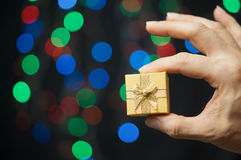 Hand of man pinch present have bokeh as background Stock Images