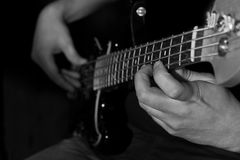 Hand of a man playing the bass guitar Royalty Free Stock Images