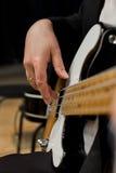 The hand of man playing bass guitar. Closeup royalty free stock photos