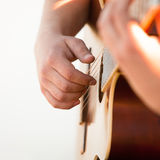 The hand of man playing guitar. Closeup Royalty Free Stock Images