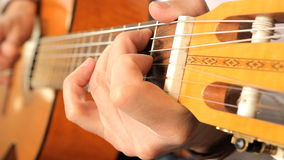 Hand of man playing guitar stock footage