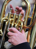 Hand of man plays the trombone in the brass band Stock Image