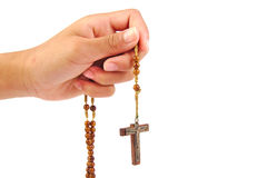 Hand of a man praying with Rosary, isolated on Stock Image
