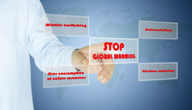 Hand of man press button stop global warming Royalty Free Stock Photography