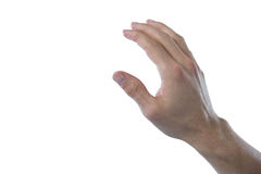 Hand of man pretending to touch an invisible screen. Against white background Royalty Free Stock Images