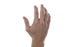 Hand of man pretending to touch an invisible screen. Against white background Stock Photos